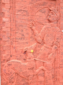 Signatures from all over the world cover the peace walls.