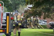 Firefighters work to put out a garage fire in Elkton, Md. (Cecil Whig)