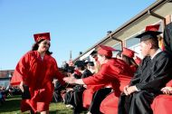 Bohemia Manor High School graduates high five after receiving diplomas. (Cecil Whig)