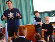 Meteorologist Justin Berk speaks to Immaculate Conception School students in Elkton, Md. (Cecil Whig)